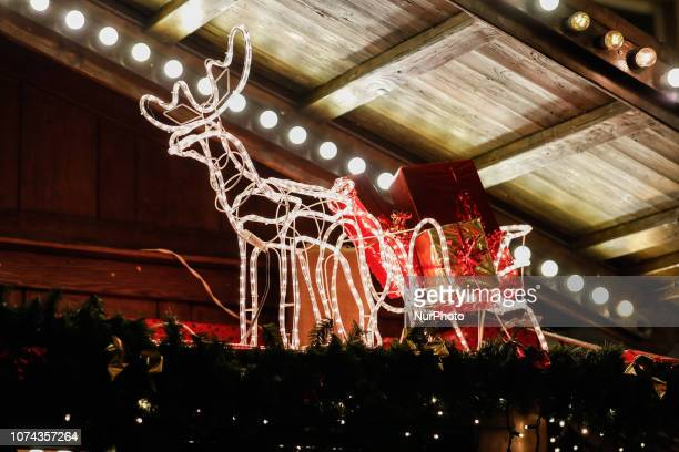 A reindeer pulling a sled with christmas presents Christmas Market in the Northern Bavarian town of Ansbach