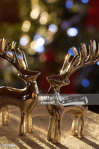 Reindeer shaped metal ornaments in sunset