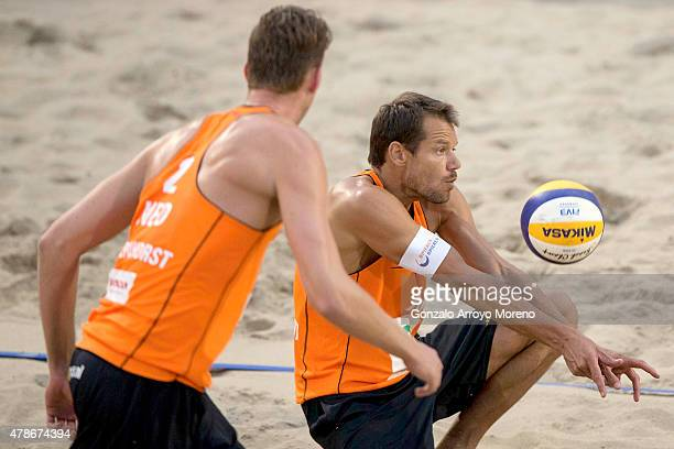 Reinder Nummerdor of the Netherlands bumps the ball behind his teammate Christiaan Varenhorst during the FIVB Beach Volleyball World Championships...