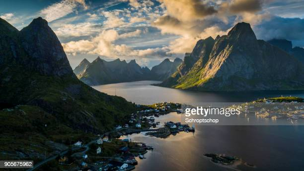 aerial: reine village and mountains of moskenesoya, lofoten islands in norway - norway stock pictures, royalty-free photos & images