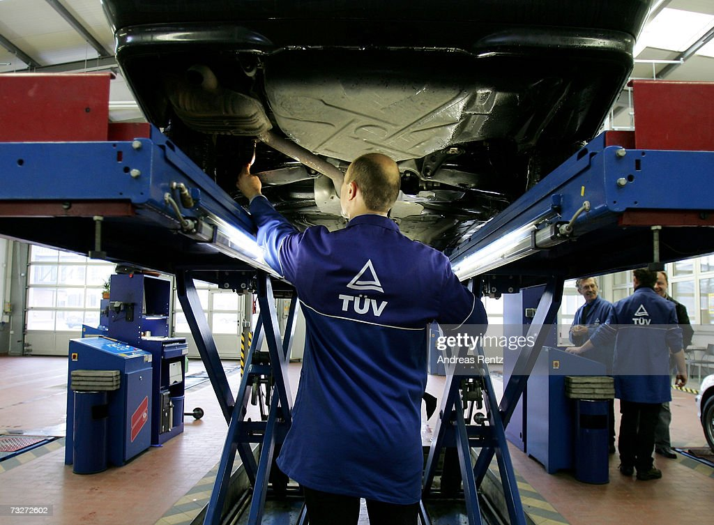 Reiner Billig, inspector of Technical Supervisory Association (TUV Rhineland), checks the underneath of a passenger car on February 9, 2007 in Berlin, Germany. The European Commission announced new carbon dioxide (CO2) targets for car makers which the European Automobile Manufacturers Association (ACEA) said it could not agree with, stating they are 'unbalanced and damaging to the European economy in terms of wealth, employment and growth potential.'