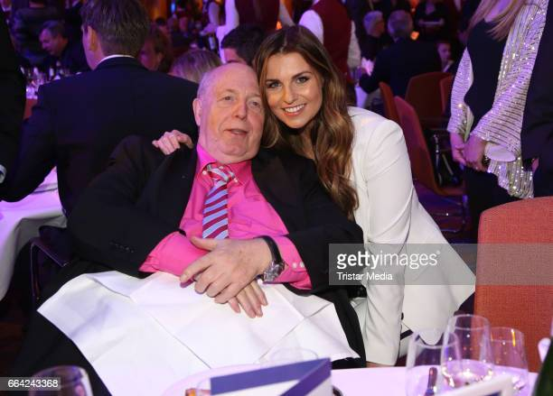 Reiner Calmund and Laura Wontorra attend the German Sports Journalism Award 2017 at Grand Elysee Hotel on April 03 2017 in Hamburg Germany
