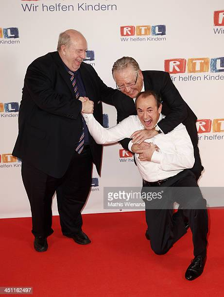 Reiner CalmundWolfram Kons and Heinz Horrmann attend the RTL Telethon 2013 on November 21 2013 in Cologne Germany