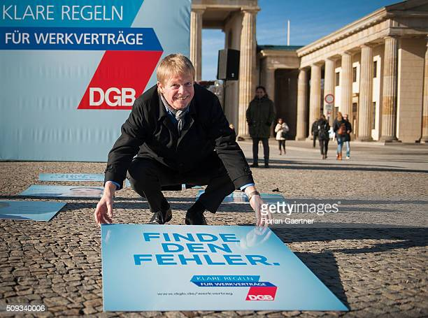 Reiner Hoffmann chairman of the German Confederation of Trade Unions uncover a placard during an action on February 05 2016 in Berlin The action...