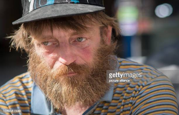Reiner Schaad the homeless man known in Frankfurt/Main as 'EisenbahnReiner' sitting in the inner city of Frankfurt Germany 14 September 2016 Usually...