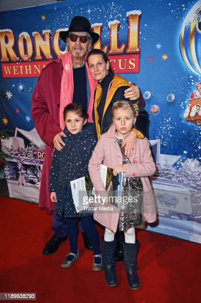 Reiner Schoene, his wife Anja Schoene, their daughter Charlotte-Sophie Schoene and a guest attend the 16th Roncalli Weihnachtscircus at Tempodrom on...