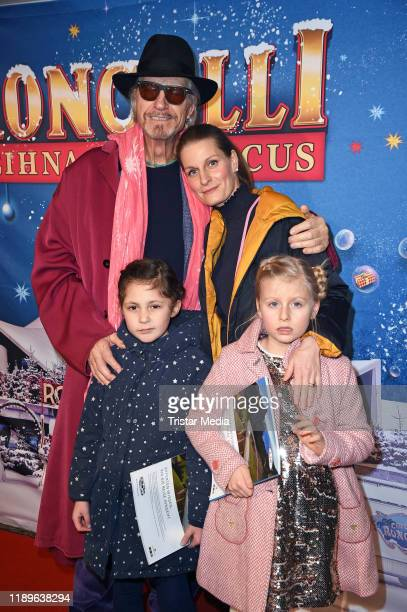 Reiner Schoene, his wife Anja Schoene, their daughter Charlotte-Sophie Schoene and a friend of her attend the 16th Roncalli Weihnachtscircus at...