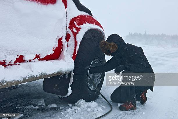 reinflating tyres of a customised 4x4 pick up truck close to laugar in north iceland - inflating stock pictures, royalty-free photos & images