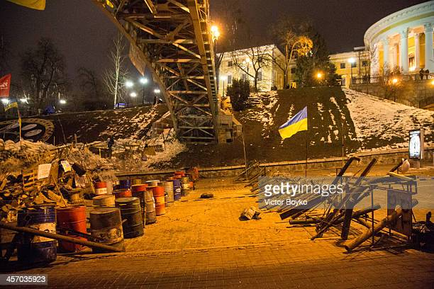 A reinforced makeshift barricade with antipersonnel obstacles and barbed wire on Instytutska street closes the access to Maidan Square on December 15...