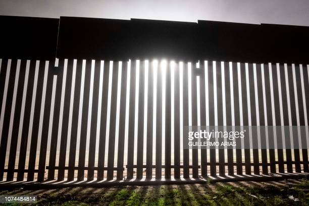 TOPSHOT A reinforced section of the USMexico border fence is seen from Tijuana Baja California state Mexico on December 20 2018 Donald Trump and...