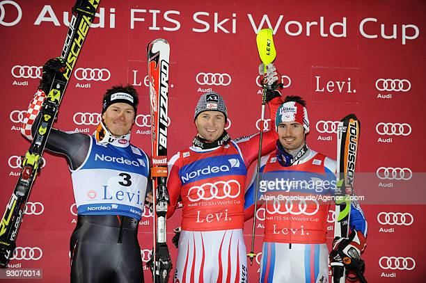 Reinfried Herbst from Austria takes 1st place Ivica Kostelic from Croatia takes 2nd place and JeanBaptiste Grange from France takes 3rd place during...