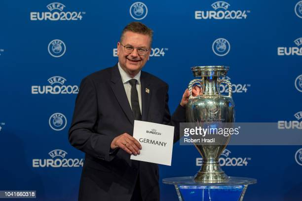 Reinhand Grindel DFB president poses with the slip and the trophy after the UEFA EURO 2024 Host Announcement Ceremony on September 27, 2018 in Nyon,...