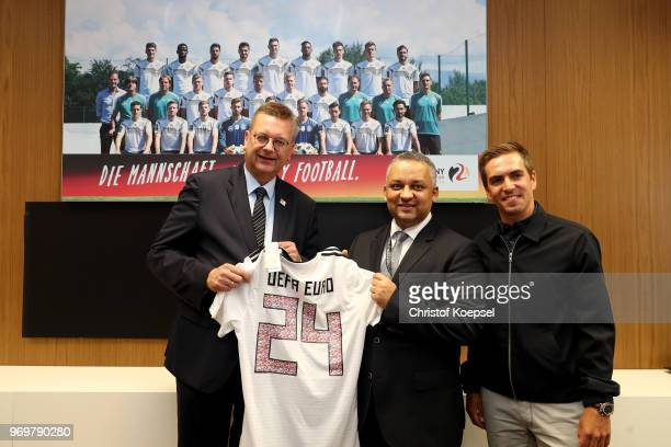 Reinhard Grindel DFB president and Philipp Lahm amabassador of 'United for Football' application for Euro 2024 hand out a jersey to Adel Ezzat...