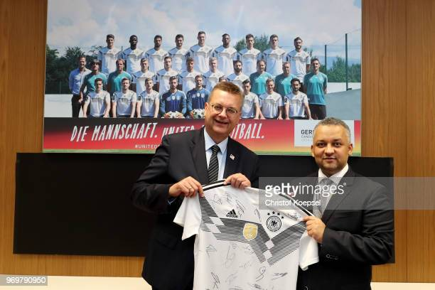 Reinhard Grindel DFB president hands out a jersey to Adel Ezzat president of the Saudi Arabia Football Federation prior to the International friendly...