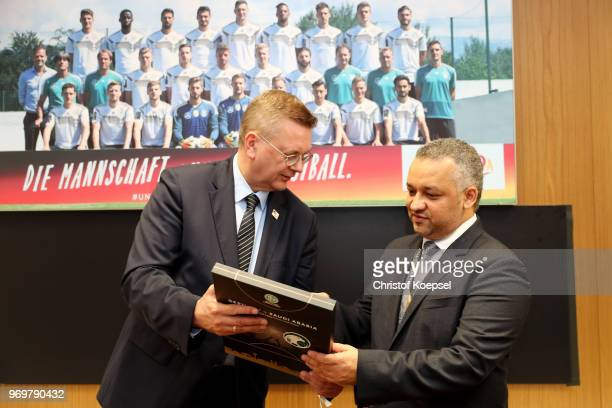 Reinhard Grindel DFB president Hans out a present to Adel Ezzat president of the Saudi Arabia Football Federation prior to the International friendly...