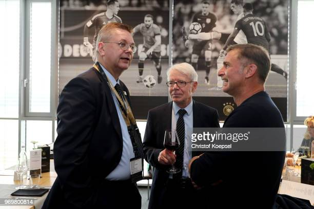 Reinhard Grindel DFB president Reinhard Rauball and Stefan Kuntz talk during the Club Of Former National Players Meeting at BayArena on June 8 2018...