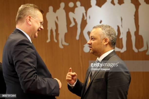 Reinhard Grindel DFB president speaks to Adel Ezzat president of the Saudi Arabia Football Federation prior to the International friendly match...