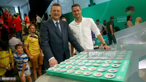 Reinhard Grindel DFB presidentn and Sebastian Kehl pose during the DFB Cup Draw at Deutsches Fussballmuseum on June 11 2017 in Dortmund Germany