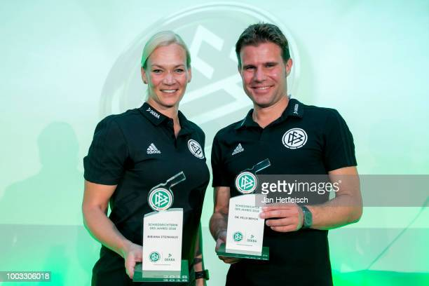 Reinhard Grindel head of the DFB Ronny Zimmermann Bibiana Steinhaus Felix Brych and Lutz Michael Froehlich pose for a picture during the awarding...