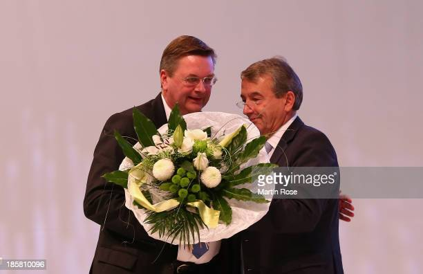 Reinhard Grindel is congratulated by DFB president Wolfgang Niersbach after his election as the new DFB treasurer during the DFB Bundestag Day 2 at...