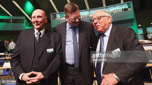 Reinhard Grindel poses with Horst Eckel and Uwe Seeler after being elected new DFB President during the extraordinary DFB Bundestag at Congress...