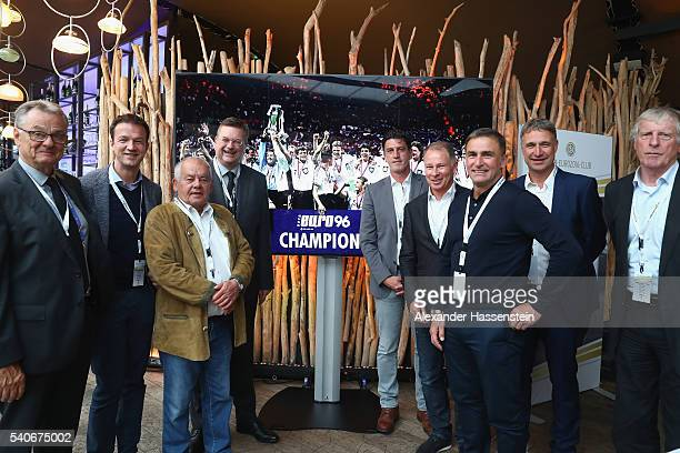 Reinhard Grindel , president of Deutscher Fussball Bund DFB pose with players and guests during the European Champions of 1996 meeting at...