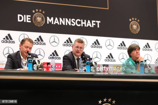 Reinhard Grindel President of the Germany Football National Federation talks to the media next to Joachim Loew head coach of Germany during the...
