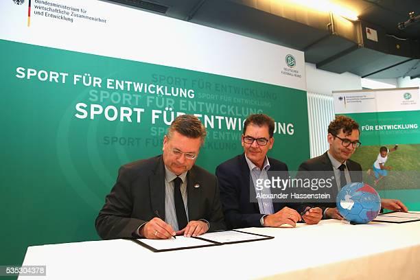 Reinhard Grindel President of the Reinhard Grindel President of Deutscher Fussball Bund DFB and DFB Secretary General Friedrich Curtius sign a...