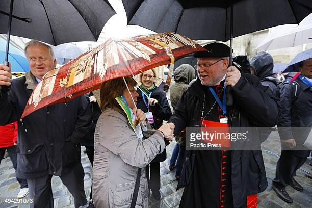 REGENSBURG BAVARIA GERMANY Reinhard Marx the Cardinal archbishop of Munich and Freising greets a woman at the Deutscher Katholikentag in Regensburg...