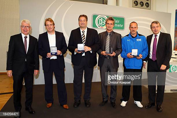 Reinhard Rauball president of Deutsche Fussball Liga DFL head coach Mike Bueskens of Fuerth stadium speaker Klaus Hafner of Mainz 05 head coach Frank...