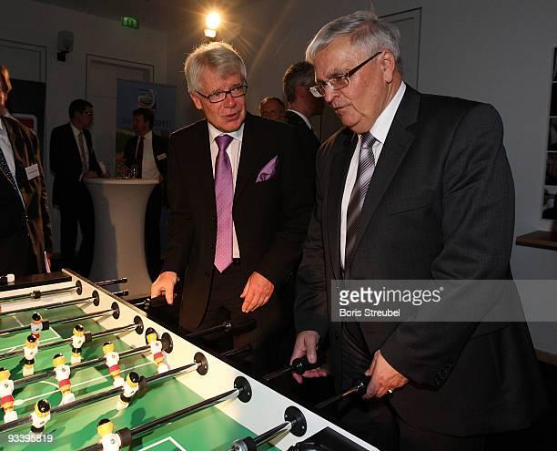 Reinhard Rauball , president of the German Football League and Theo Zwanziger , president of the German Football Association play kicker during the...