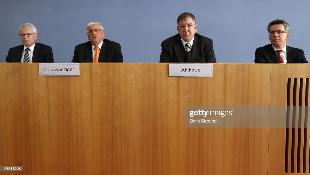 Reinhard Rauball, president of the German Football League (DFL), Theo Zwanziger, president of the German football association (DFB), Christoph Ahlhaus, Interior Minister of the german state of Hamburg and head of the interior minister conference (IMK) and Thomas de Maiziere, German Interior Minister attend the press conference after the round table discussion on the subject of 'Gewalt im Zusammenhang mit Fussballspielen' (Violence in football) during the interior minister conference at the Bundespressekonferenz on April 23, 2010 in Berlin, Germany.