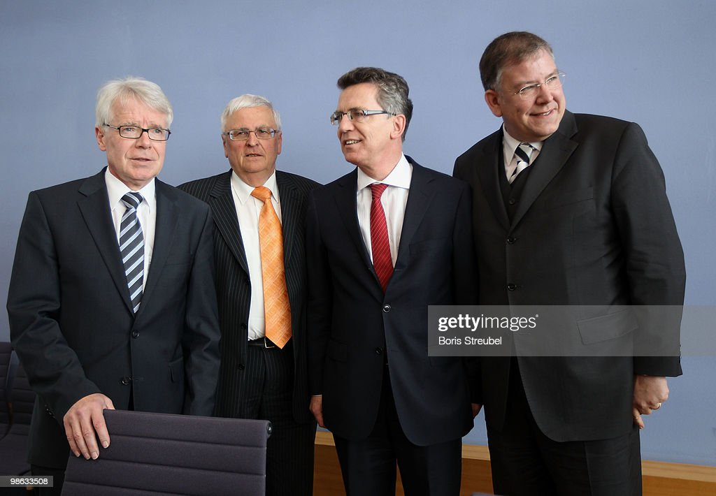 Reinhard Rauball, president of the German Football League (DFL), Theo Zwanziger, president of the German football association (DFB), Thomas de Maiziere, German Interior Minister and Christoph Ahlhaus, Interior Minister of the german state of Hamburg and head of the interior minister conference (IMK) attend the press conference after the round table discussion on the subject of 'Gewalt im Zusammenhang mit Fussballspielen' (Violence in football) during the interior minister conference at the Bundespressekonferenz on April 23, 2010 in Berlin, Germany.