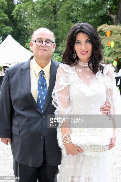 Reinhard Soell and his partner Swetlana Panfilow attend the Thurn Taxis Castle Festival 2018 'Tosca' Opera Premiere on July 13 2018 in Regensburg...