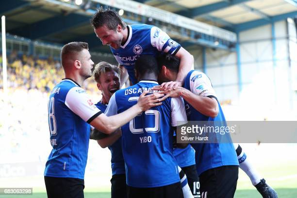 Reinhold Yabo of Bielefeld celebrate his second goal with his team mates during the Second Bundesliga match between DSC Arminia Bielefeld and...