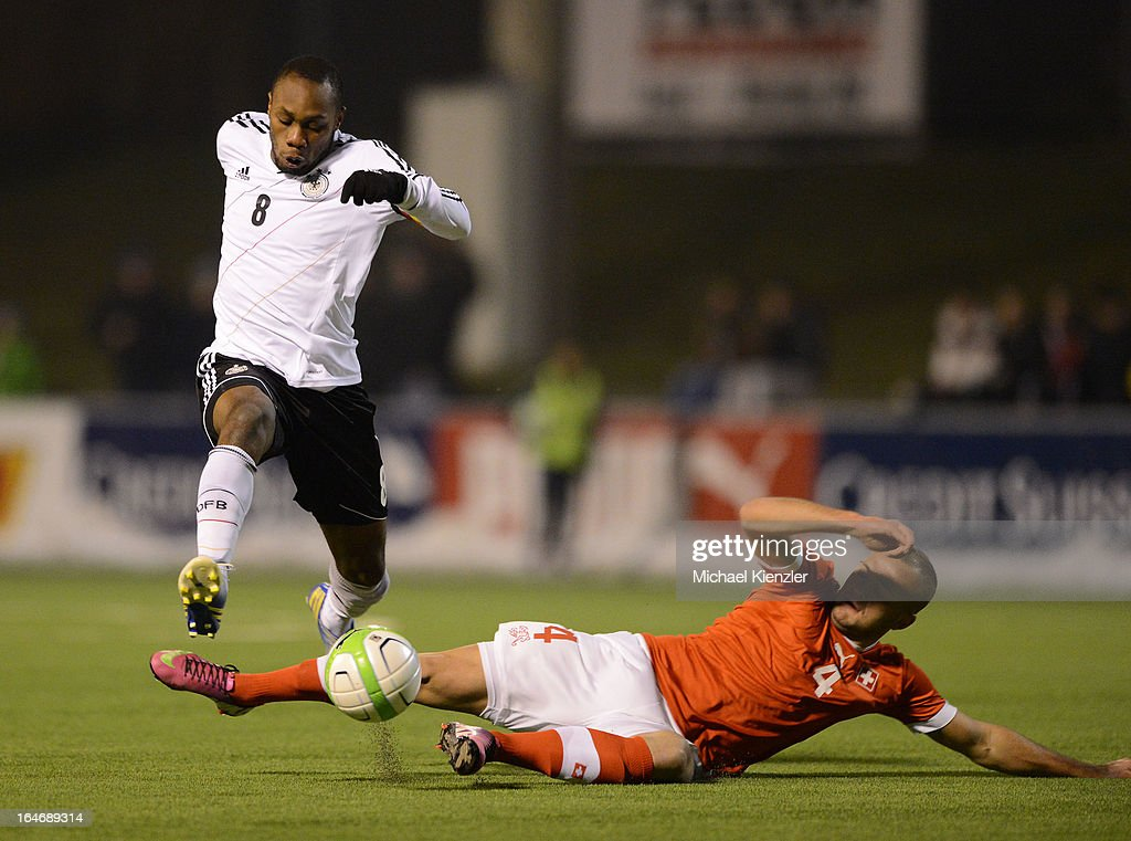 Reinhold Yabo of Germany (L) challenges for the ball with Arlind Ajeti of Switzerland during the international friendly match between U20 Switzerland and U20 Germany at Eps Stadium on March 26, 2013 in Baden, Switzerland