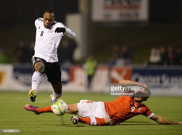 Reinhold Yabo of Germany challenges for the ball with Arlind Ajeti of Switzerland during the international friendly match between U20 Switzerland and...