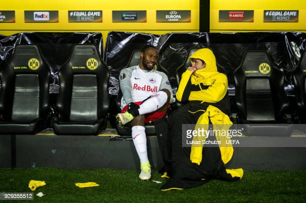 Reinhold Yabo of Salzburg talks to Mario Goetze of Dortmund after the UEFA Europa League Round of 16 match between Borussia Dortmund and FC Red Bull...