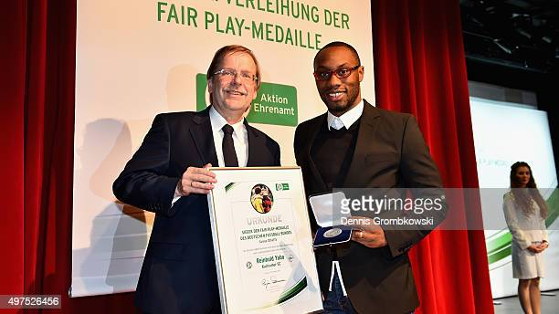 Reinhold Yabo poses with Rainer Koch during the Fair ist mehr and Club 100 Awarding Ceremony on November 17 2015 in Hanover Germany