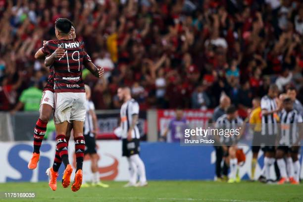 Reinier and Vitinho of Flamengo celebrate a scored goal during a match between Flamengo and Atletico MG as part of Brasileirao Series A 2019 at...