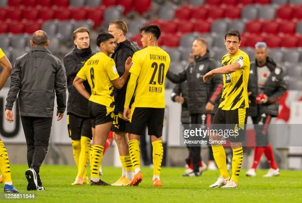 Reinier Mahmoud Dahoud and Thomas Delaney of Borussia Dortmund after the final whistle during the DFL Supercup match between FC Bayern Muenchen and...