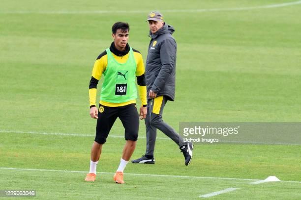 Reinier of Borussia Dortmund and head coach Lucien Favre of Borussia Dortmund look on during the Borussia Dortmund Training session on October 13...