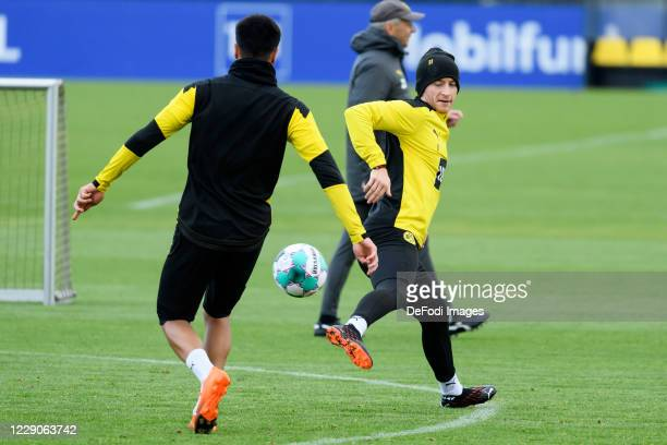 Reinier of Borussia Dortmund and Marco Reus of Borussia Dortmund battle for the ball during the Borussia Dortmund Training session on October 13 2020...