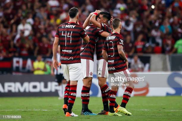 Reinier of Flamengo celebrates with teammates after scoring his team's third goal a match between Flamengo and Atletico MG as part of Brasileirao...