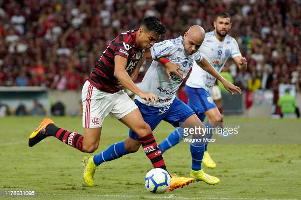 Reinier of Flamengo competes for the ball with Carlinhos of CSA at Maracana Stadium on October 27 2019 in Rio de Janeiro Brazil