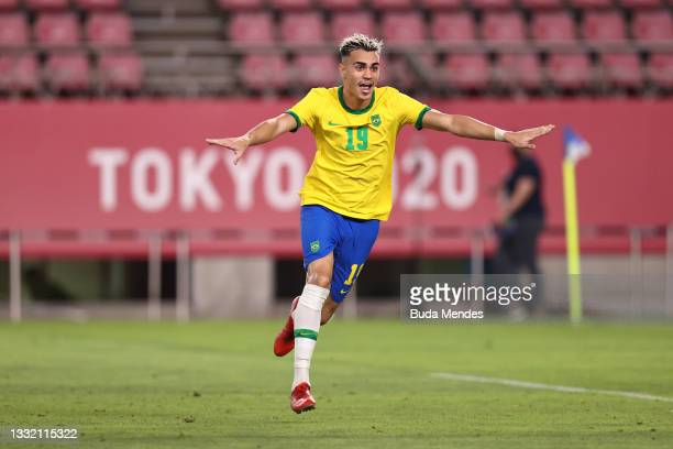 Reinier of Team Brazil celebrates after scoring their side's winning penalty during the penalty shoot out during the Men's Football Semi-final match...