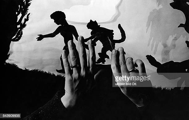 Reiniger Lotte Silhouette animator film director Germany*02061899working on an animation fim her hands and silhouette characters Photographer Paul...