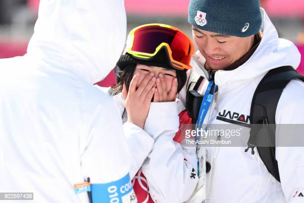 Reira Iwabuchi of Japan is consoled by coaches after the Snowboard Ladies' Big Air Final on day thirteen of the PyeongChang 2018 Winter Olympic Games...