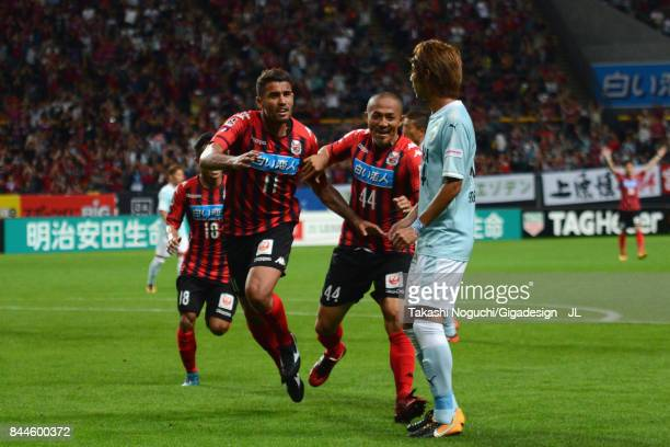 Reis of Consadole Sapporo celebrates scoring his side's second goal with his team mate Shinji Ono during the JLeague J1 match between Consadole...
