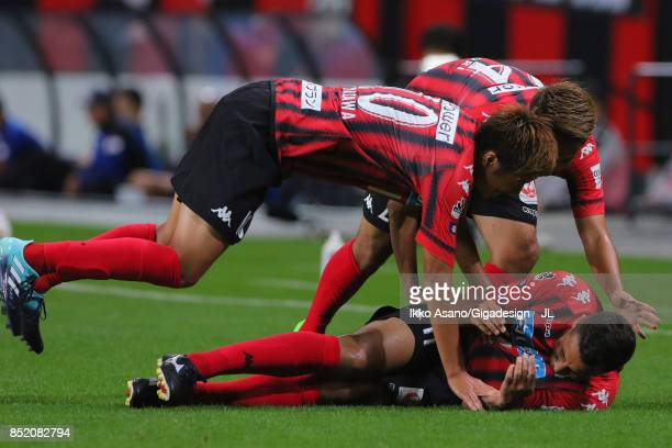 Reis of Consadole Sapporo celebrates scoring his side's second goal with his team mates Hiroki Miyazawaand Akito Fukumori during the JLeague J1 match...